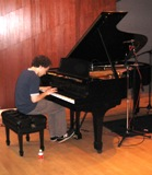 Pianist Orion Weiss trying out the KUHF Steinway