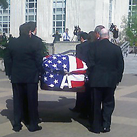 image of casket being carried to the rotunda