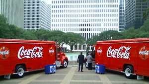 image of two coke trucks
