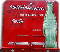 image of the back of a coke truck reads: Did you know the hybrid electric truck reduces emissions in our city