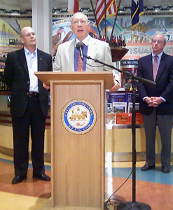 Mayor Bill White at a press podium