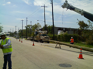 image of cp workers fixing power lines