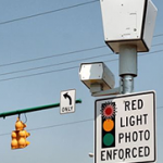 Houston red light runners, beware.  If you're caught on  camera running a red light, and don't pay the ticket you won't be able to register your vehicle until it's paid.