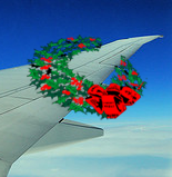 image of plane with holiday wreath on the wing
