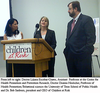 photograph of From left to right: Doctor Liliana Escobar-Chaves, Assistant  Professor at the Center for Health Promotion and Prevention Research, Doctor Deanna Hoelscher, Professor of Health Promotion/Behavioral sciences the University of Texas School of Public Health and Dr. Bob Sanborn, president and CEO of Children at Risk