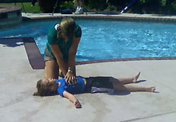A woman rescues a mock drowning victim