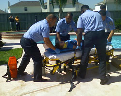 Fire fighters evacuate a mock drowning victim