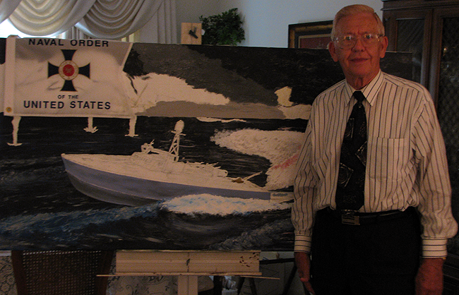 image of Clyde Combs in front of a painting of patrol torpedo boat