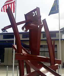 image of new sculpture made of steel beams from the burned warehouse with the number 31 to honor the firefighters