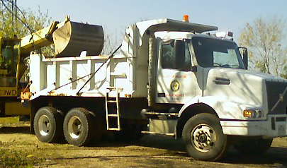 Public Works truck filling up with crushed rock