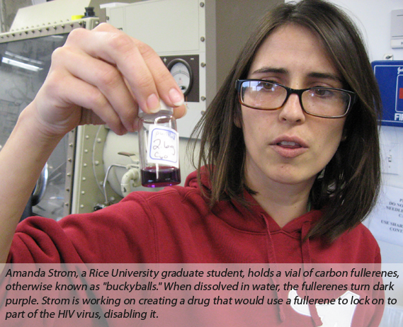 Amanda Strom, a Rice University graduate student, holds a vial of carbon fullerenes, otherwise known as 'buckyballs.'