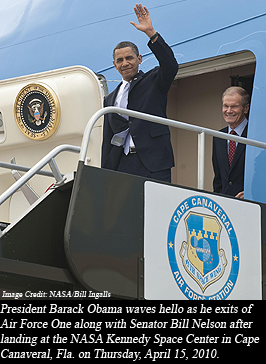 President Barack Obama waves hello as he exits of Air Force One