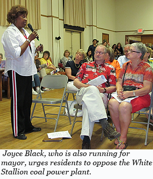 Joyce Black, who is also running for mayor, urges residents to oppose the White Stallion coal power plant.