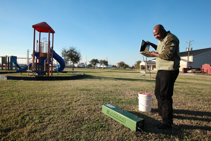 Hilton Kelley testing contamination levels near a playground