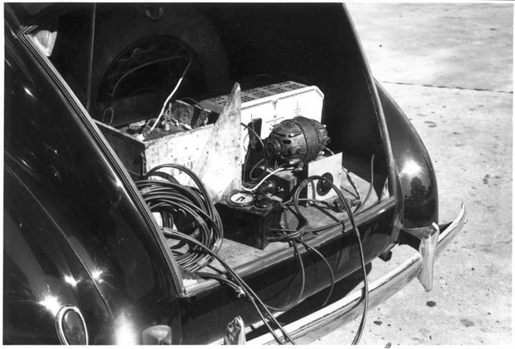 open trunk showing recording equipment