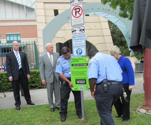 Old parking signs are removed near Houston's Minute Maid Park.