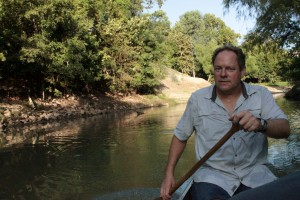 Tom Helm paddles down Buffalo Bayou