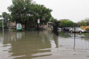 High water floods Fleming Drive in east Houston after torrential rains on Saturday.