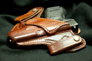 A  concealed gun inside a holster