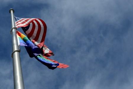 us and pride flag waving on pole