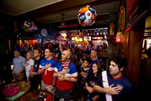 Fans of the United States soccer team sing the American anthem a few minutes before the beginning of the World Cup 2014 game against Belgium, Tuesday, July 1, 2014, at the The Richmond Arms Pub in Houston.