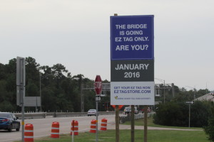 Signs at HCTRA Ship Channel Bridge advising drivers of conversion to all-electronic tolling.