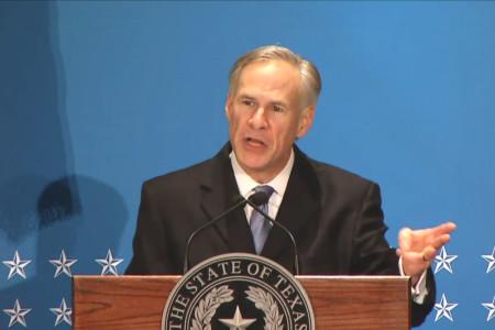 Governor Greg Abbott speaking at the podium