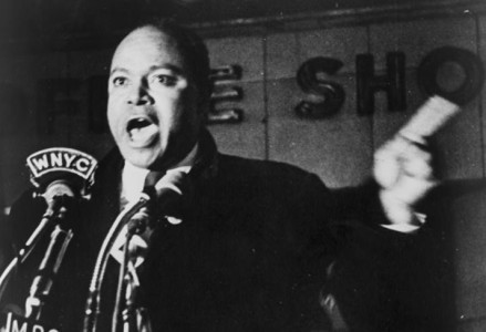 James Farmer speaking on microphones