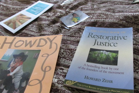 Restorative Justice books lie on a blanket at the Academy of Choice