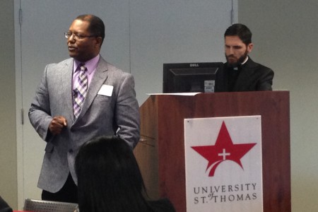 Willie Bennett (left), senior organizer for The Metropolitan Organization, and Father Christopher Plant (right), Pastor at Houston's Resurrection Catholic Community, led a presentation in which they analyzed factors that cause economic disparities in our city.