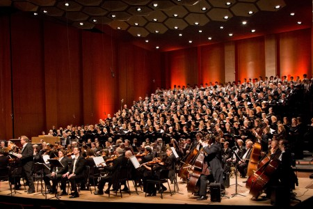 Houston Symphony orchestra and chorus on stage in Jones Hall