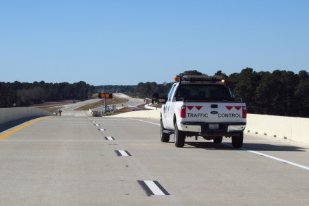 TxDot truck sits at the top of the newly paved toll road