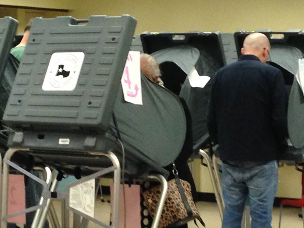 A man participates in the first day of early voting in Texas at the Metropolitan Multi-Service Center, located in Midtown Houston.