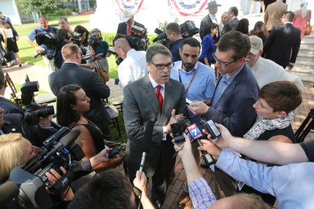 Perry in front of reporters