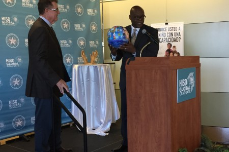 HISD Superintendent Terry Grier receives a parting gift, some artwork by students, from HISD's community liaison Lawrence Allen at a goodbye celebration last week.