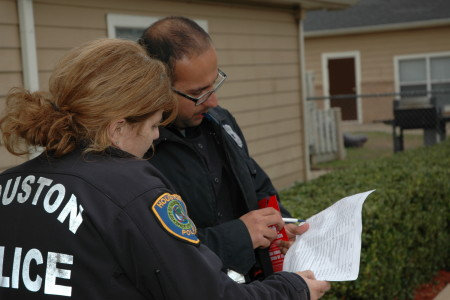 Two Houston Police Officers preparing to serve a warrant during the 2015 warrant round up.