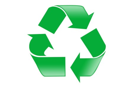 A green recycle symbol on a white background