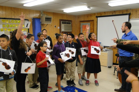 Houston Symphony bassist David Connor with students at Crespo Elementary