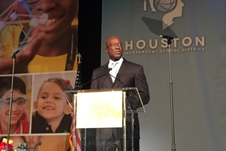 HISD Interim Superintendent Ken Huewitt called on the entire Houston community to do more to help poor children at the annual State of the Schools address.