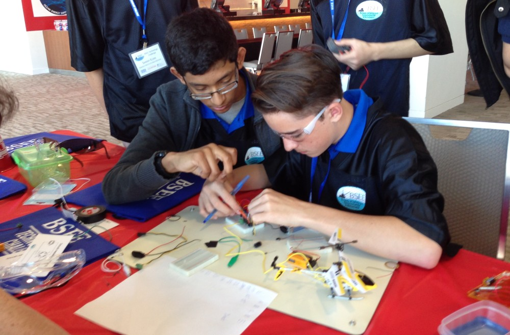 Jose Saravia and Matthew McEwan review the connections of one of the devices they used in the competition.