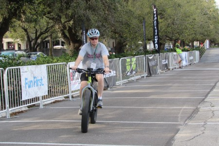 A rider tries out an electric bike at Rice University.