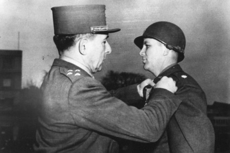 A French officer decorates Lt. Col. James Earl Rudder with a medal for valor