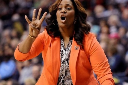 Dawn Brown holds up four fingers