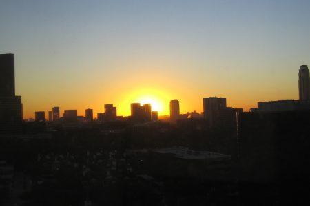 Sun rising over the Houston skyline