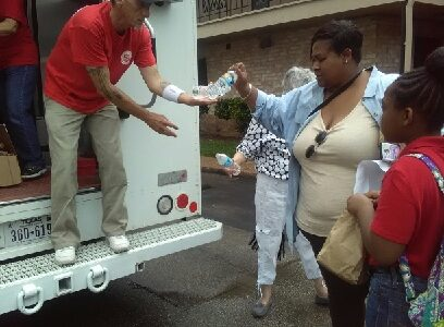 Delivering essential food items to flood victims.
