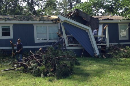 The strong winds caused several trees to fall on top of about a dozen homes located in the Willow Oaks Trailer Park, near Tomball, causing extensive damage.