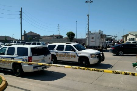 Harris County Sheriff's Office deputies respond to a shooting Wednesday morning at a business in Katy.
