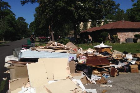 Residents of the Timber Lakes-Timber Ridge subdivision, located in The Woodlands area, put many belongings they couldn't use any more due to the flooding on the curve for clean-up crews to pick them up.