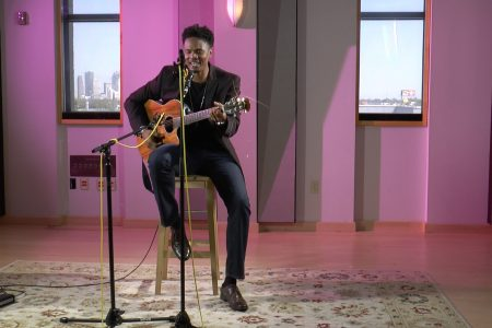 "Video: Tony Henry Performs Prince's ""She's Always In My Hair"""