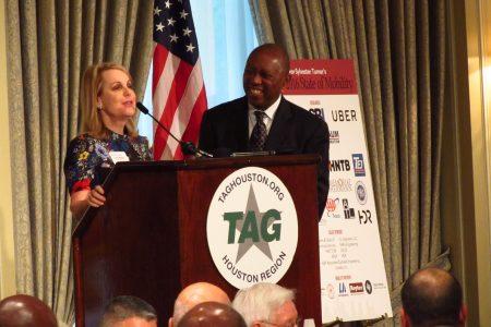 Patman introduces speaker Turner at a podium